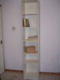 Tall, narrow, sturdy shelving unit. White laminate with adjustable shelving.W 40cm x D28cm xH202cm