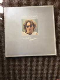 John Lennon record collection with added extras