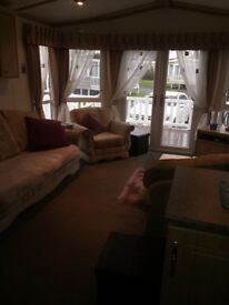 Lovely holiday home at Seton Sands. Premier pitch close to all amenities. 3 bedroom with decking.