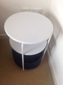 Pair of small round tables with storage basket
