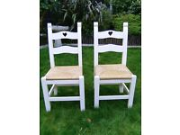Pair of oak dining chairs with carved hearts