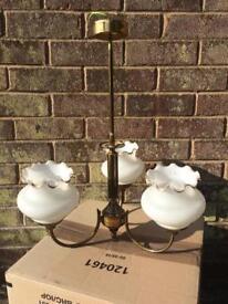 Brass three shade pendant ceiling light.
