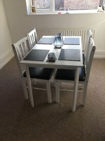White Dining Table with Four Chairs