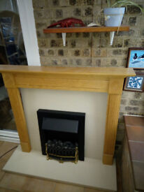 Electric fire with hearth, surround and mantle piece