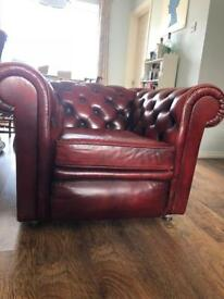 Ox blood red chesterfield club chair. Can deliver locally
