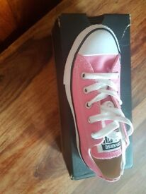 Brand new pink Converse size 11.5 bought for my little girl with two big.