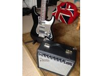 Squier Stratocaster and Fender Champion Amplifier