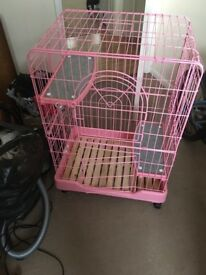 Pink small animal cage