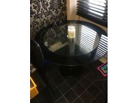 Beautiful round clear glass dining table