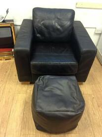 Brown leather armchair with footstool
