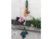 Garden strimmer with extendtable height with long cord