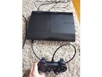 PS3 Super Slim 500GB with controller and 6 games