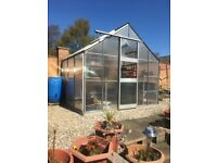 Greenhouse with staging, cold frame, water butts and composters