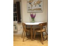 FOR SALE: Second hand Habitat 2-4 seater dining table with two chairs. Collection only