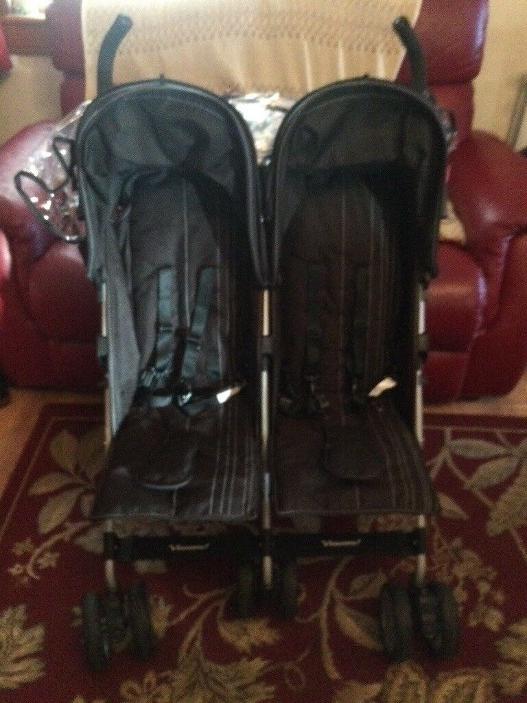 Twin buggy with 2 cosytoes and rain cover. Immaculate condition. Used 3 times at granny's.