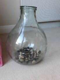 Glass bottle with pebbles included.vgc.Must pick up as heavy.