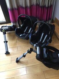 Two maxi cosi baby seats with isofix bases