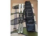 Skis, poles and bag