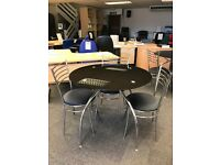 Two Glass Bistro Tables, With 7 Matching Chairs