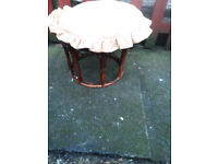 brown cane stool with cushion