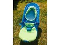 Baby bouncer with vibrate and head support