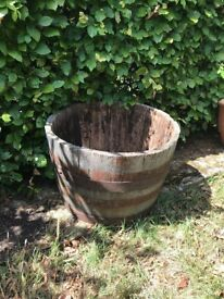 Wooden old barrel planter with metal rings
