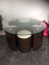 Brown table with glass top and stools