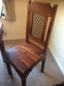 Solid Balinese dark wood dining table and six chairs