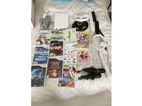 Nintendo Wii console - including 11 of games, 2 controllers and accessories