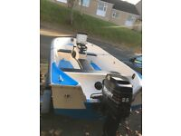 14 ft open boat and 25 Mercury outboard with trailer