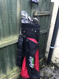 Golf clubs with bag.