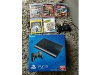 PS3 plus Dualshock 3 controller and 5 games