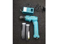 Makita Drill two batteries and charger.