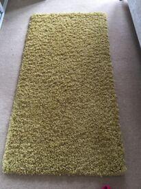 Mustard / gold rug
