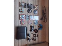 ps3 super slim with 6 games 2 controllers 2 mics