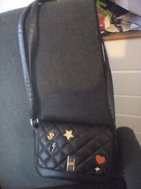 black rock-themed handbag