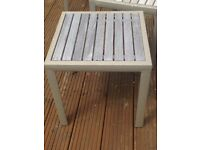 Two hardwood square garden tables