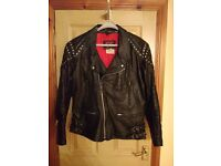 TT Leathers black leather motorcycle jacket