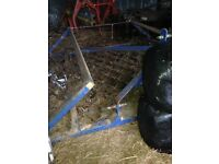 12foot folding chain harrow , good condition.barn stored. All chains in tact.