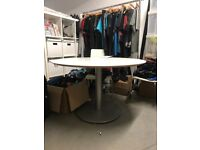 Large circular meeting table on metal base. Free. Collection from West London