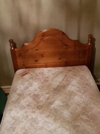 Single bed with solid wood headboard and base and orphapedic matress