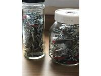 Two very large jars of screws