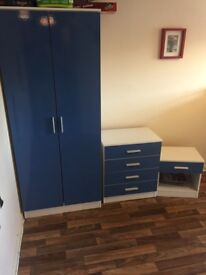 3 piece matching blue wardrobe, drawers and bed side cabinet.