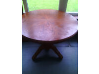 Old style built to last round dining table and four chairs