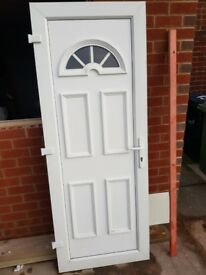 White UPVC exterior door. Great condition