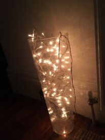 Cracked glass vase with fairy lights