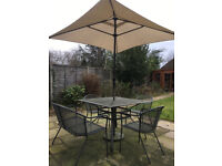 Garden table, bench, chairs and umbrella