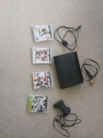 PlayStation 3 slim with some games
