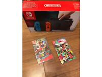 Brand new Nintendo switch + 2 games full warranty and receipt