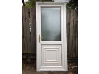White UPVC door with obscure glazing to the top